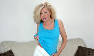 Busty mature Sharon Kane strips from lingerie and shows hairy slit