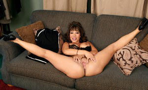 Mature asian slut Ava Devine brings out big tits and stretches cunt