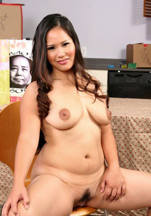 Fat asian MILF Jessica Bangkok strips and pleases shaved pussy