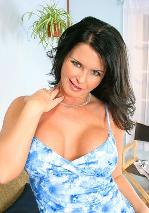 Busty mom Maya Divine goes topless and poses in blue panties