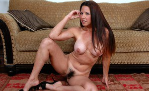 Mature babe Selena Steele brings out huge tits and spreads hairy pussy