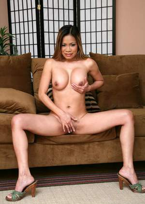 Tempting asian mom Mika Tan strips comely breast from a satin dress