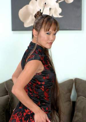 Luxurious asian seductress Mia Smiles poses in stockings and underwear