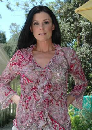 Mature lady in beige lingerie India Summer strips and spreads outdoor