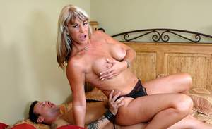 Beauteous mature Cat Cleavage fondling tits and riding big cock