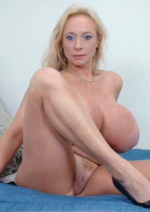 Mature blonde Echo Valley showing off insanely huge tits