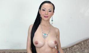 asian mature Ange Venus demonstrates huge tits and lovesome pussy