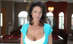 mature seductress Deauxma flashing giant hooters and exposes butt