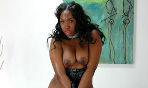 Black babe in stockings Angel Eyes exhibits her ripe round ass