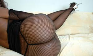 Black hottie Nyomi Banxxx showing off booty in fishnet pantyhose