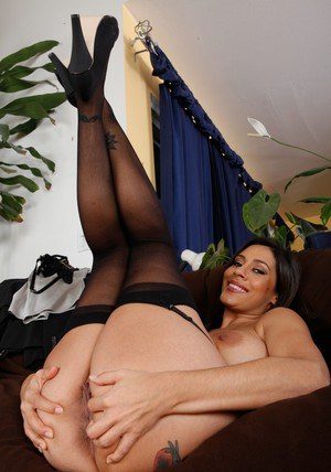 Shapely MILF in black stockings and heels spreads her hairy pussy