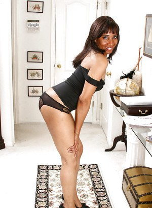 Black mature with small tits revealing her booty from see-thru panties