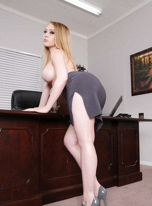 Sexy office babe in glasses Kagney Linn Karter strips and shows juggs
