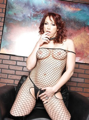 Slutty MILF in fishnet bodystockings and boots spreading tight asshole