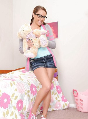 Nerdy pigtailed latina in glasses Lana Lopez strips and gets spanked