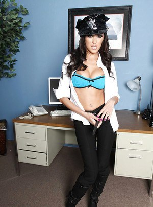 Sexy uniformed lady cop Breanne Benson stripping in her office
