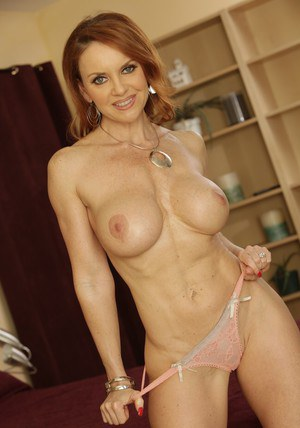 Busty MILF Janet Mason strips off elegant lingerie and poses solo