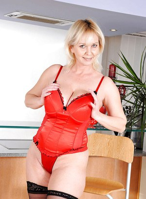 Plump mature strips off red underwear and shows off in stockings