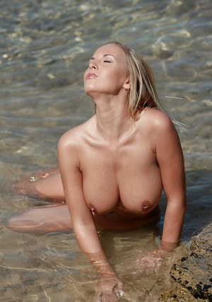 Big titted babe pornstar playing with herself in the water outdoor