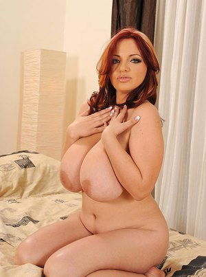 Fatty Joanna Bliss with big tits is spreading her legs to show her ass