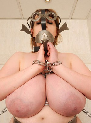 Busty gorgeous fatty girl is chained and ready for a punishment