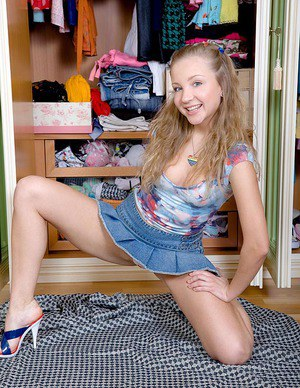 Cute euro teen with small tits strips and toys her tiny cunt