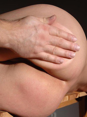 Submissive brunette Abbie Cat gets her shapely ass spanked hard