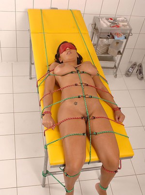 Evil nurse Eve Angel provides a restrained patient with deep anal exam