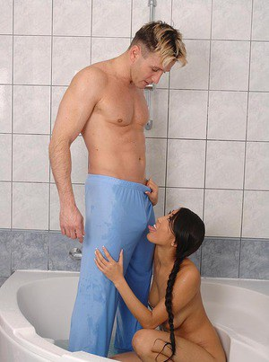 Asian babe Sharon Lee giving an outstanding blowjob in the bathroom