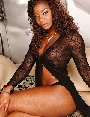 Ebony babe is stripping off lingerie to finger her tight butthole