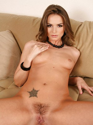 Sizzling babe in knee high boots Tori Black flaunting nude on the couch