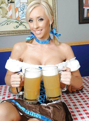 Blonde babe Jessica Lynn with big tits in server uniform is stripping