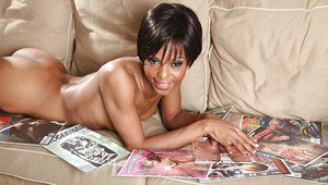 Ebony babe Marie Luv on high heels is stripping to show her wet pussy
