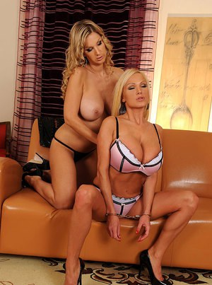 Busty lesbians Carol and Sharon Pink licking and toying each other