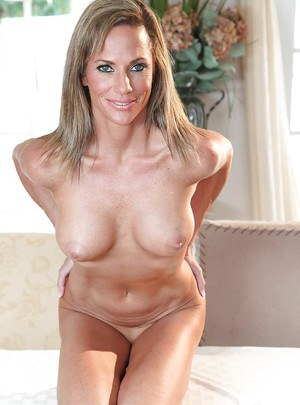Mature housewife with big tits Montana Skye is teasing her hooters