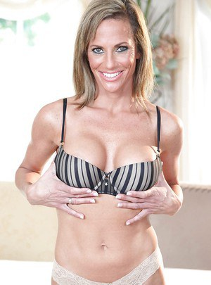 Mature MILF Montana Skye with big boobs takes off her shorts