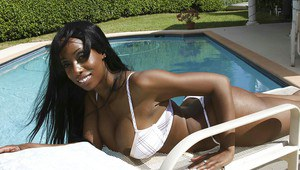 Ebony babe Codi Bryant shows her sexy body outdoor by the pool