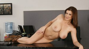Horny Sara Stone with big melons gets undressed on the office table