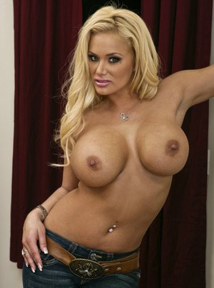 Gorgeous MILF Shyla Stylez exposes her boobs and teases her hot pussy