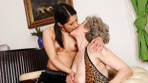Mature lady is licking and kissing her young lesbian babe's pussy
