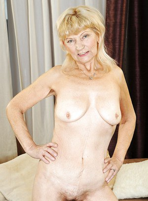 Very old granny is showing her hairy pussy and tiny tits