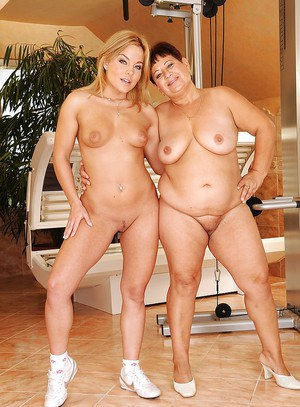 Mature lesbian with big hooters is posing with a sweet naked teen babe