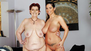 Daisey Lee with huge tits is playing with her mature lesbian friend