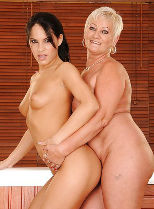 Young lesbian is playing with her naked chubby mature lady