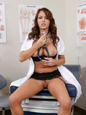 Sexy doctor Jenna Presley stripping off uniform to finger her pussy