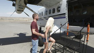 Big titted pornstar Gina Lynn gets fucked right in the plane