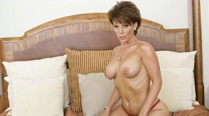 Lovely MILF with huge boobs Kayla Synz masturbating her craving twat