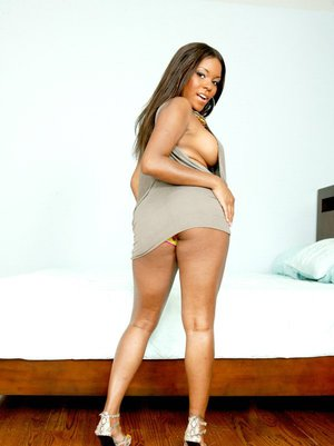 Ebony wife Candice Nicole strips off panties to show her hot butt