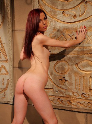 Slim redheaded hottie slips out of leopard lingerie and poses nude