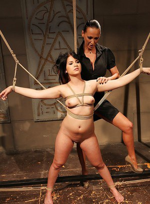 Mistress Mandy Bright tortures a bound hottie and fucks her with a toy